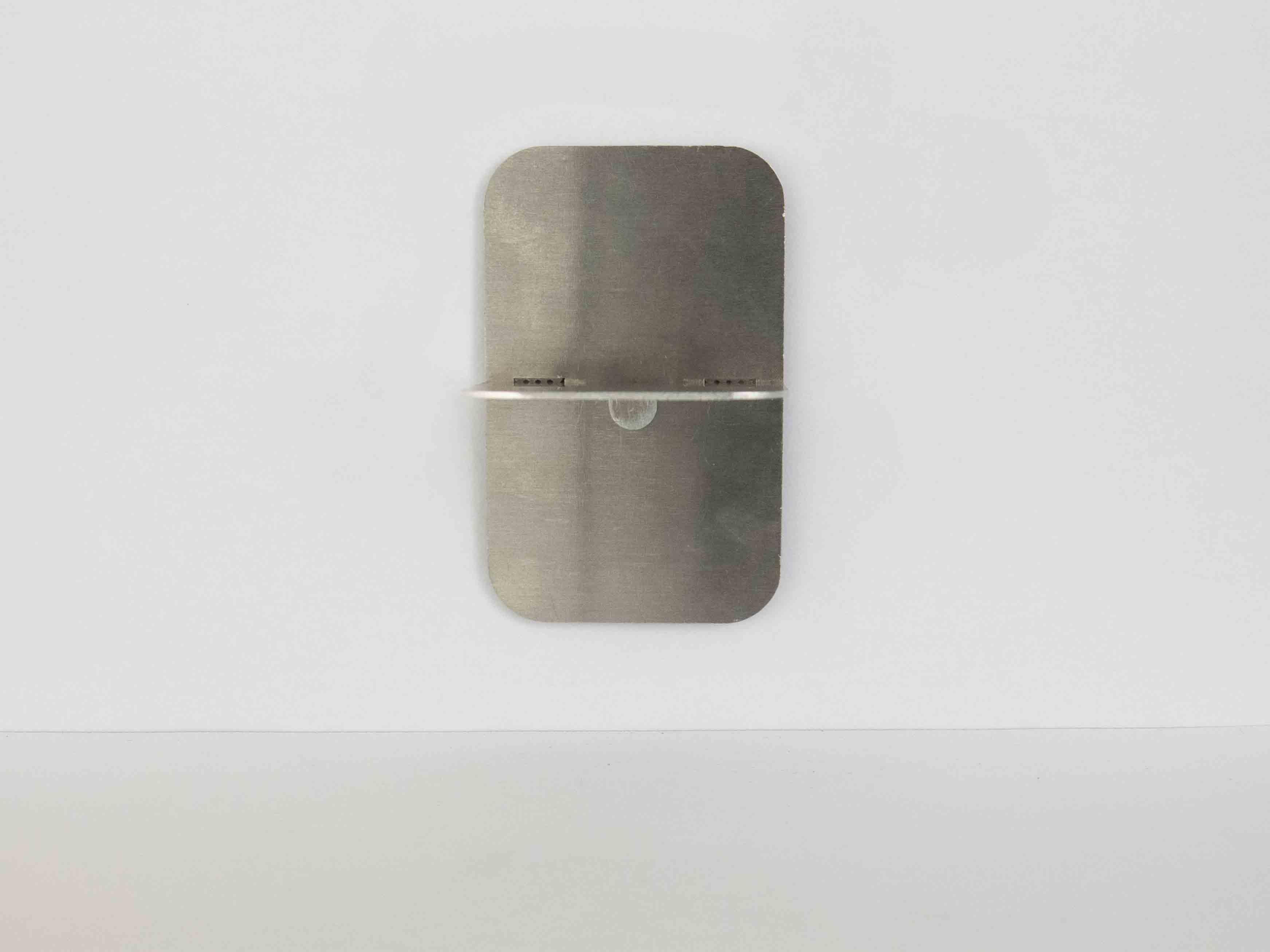 Laser cut metal fastening perpendicular clipsing on wall