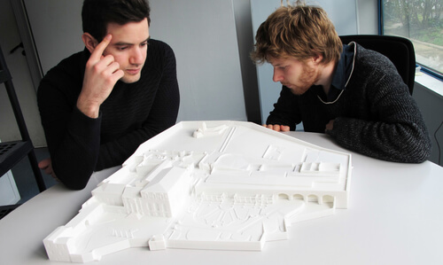 Our team members contemplating the model