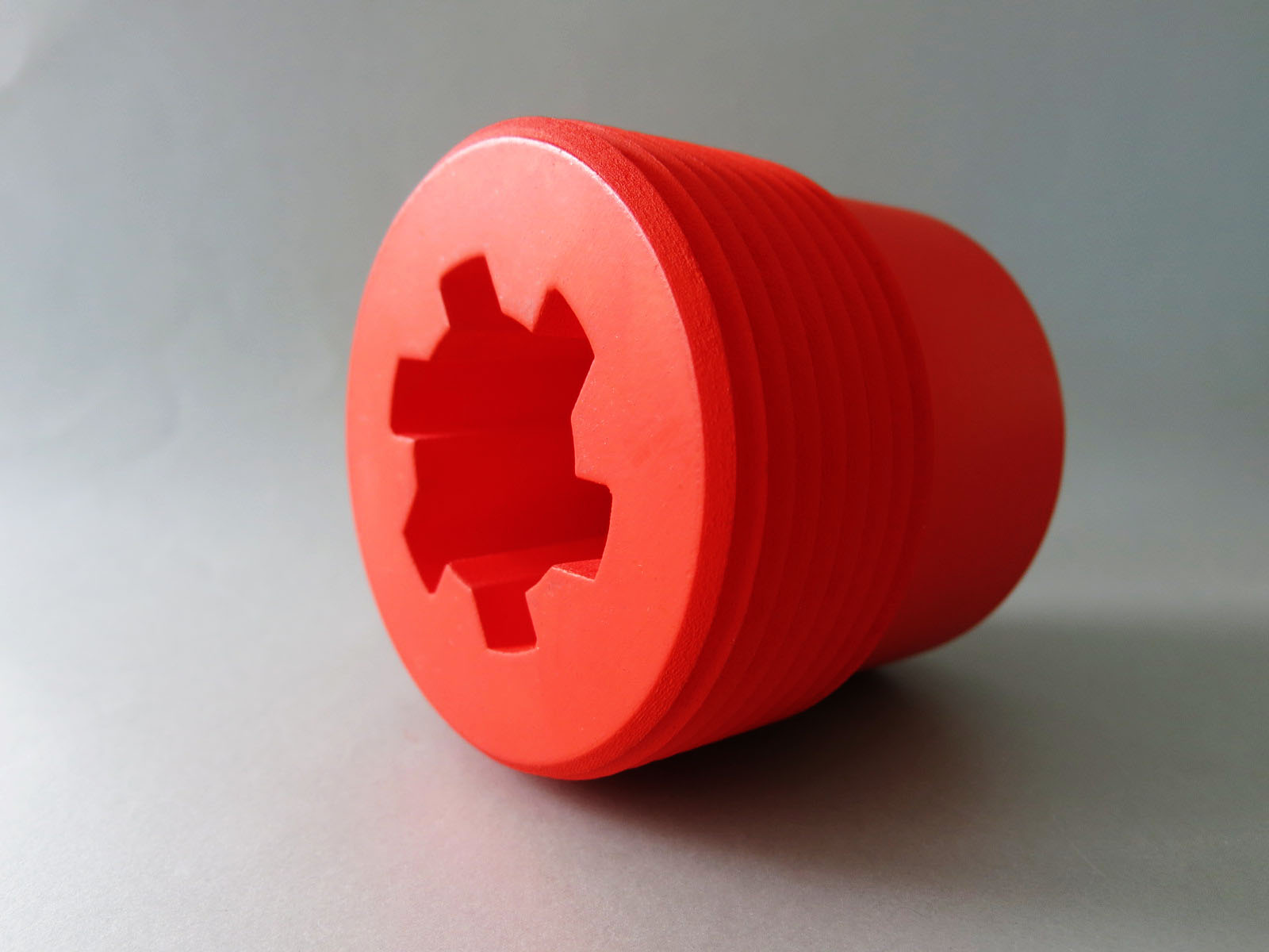 Set of 3D printed objects in black, translucent red and transparent resin