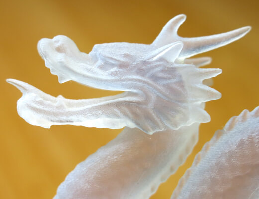 Close up of 3D printed transparent resin dragon's head - Thumbnail - Small image