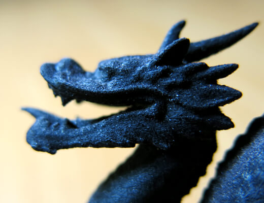 Close up of a black resin 3D printed drangon's head and its texture - Large