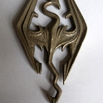 /media/picture/thumb/2012/03/08/oHqo/elder-scrolls-v-skyrim-pendant-the-imperial-symbol-1_size_410..JPG