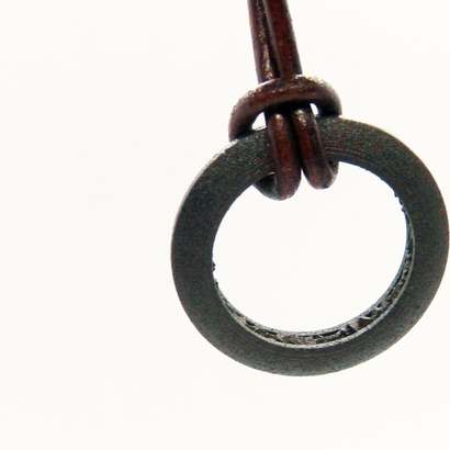 Ring shaped pendant with a raw band inside