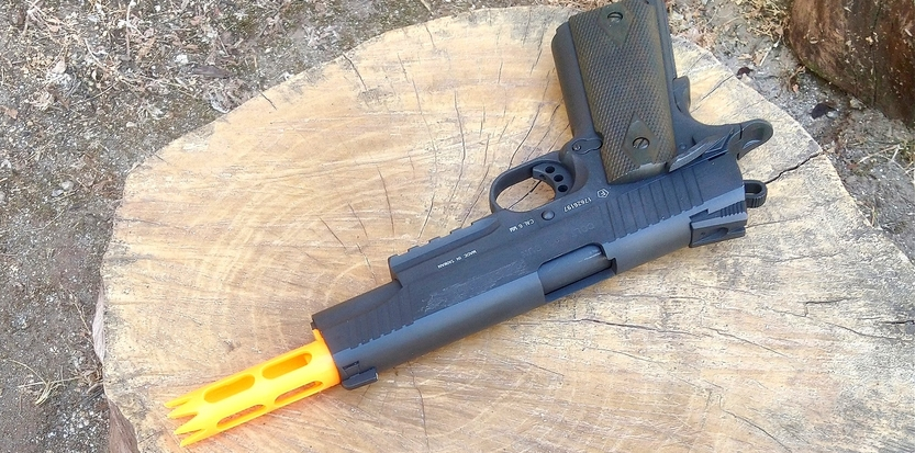 /media/picture/thumb/2019/08/09/NAzt/orange-version-on-colt-1911-tac-top-quarter-small_size_833x413.jpg