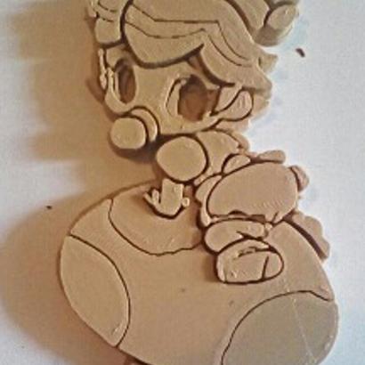 bas-relief-baby-peach-on-mushroom